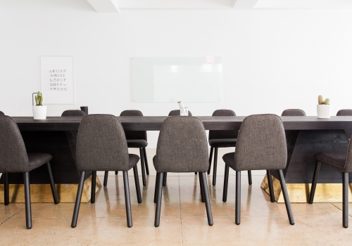 long conference room table and chairs